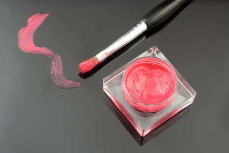 gloss: lip gloss container and applicator brush Stock Photo