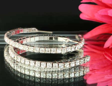 diamond earings on reflective tray