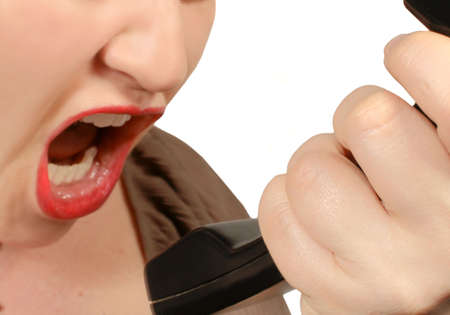 loudness: woman yells into telephone