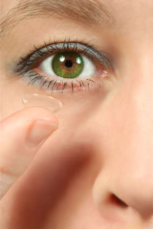 corrective contack lens and eye Stock Photo