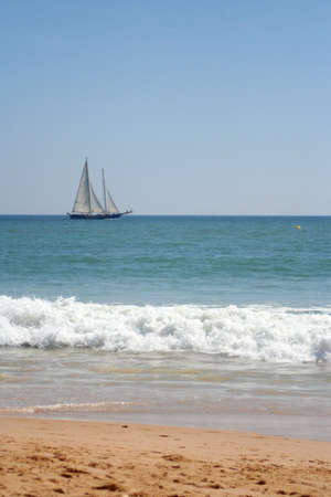 sailboat crosses the horizon