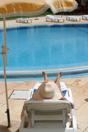 woman relaxes by the pool Stock Photo - 378112