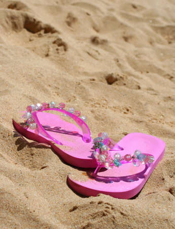 pink sandals in the sand