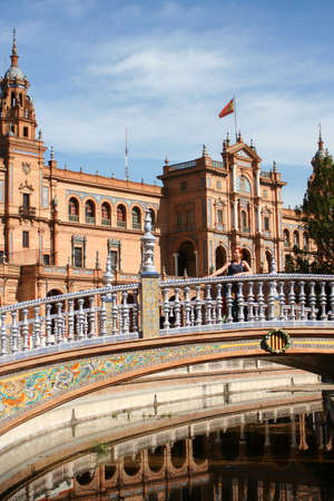 espana: Woman on bridge at Plaza de Espana in Seville, Spain Stock Photo