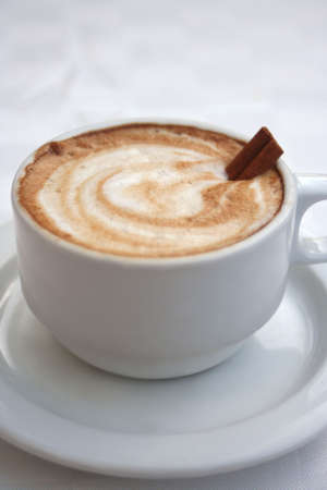 frothy: frothy coffee with cinnammon stick