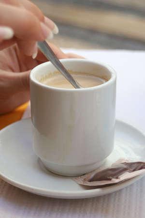 woman's hand stirs coffe Stock fotó - 380696
