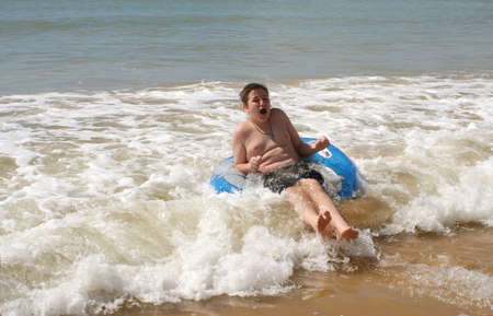 boy gets washed ashore by waves photo