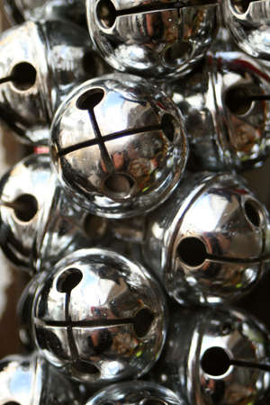 silvery: silver cattle bells close up