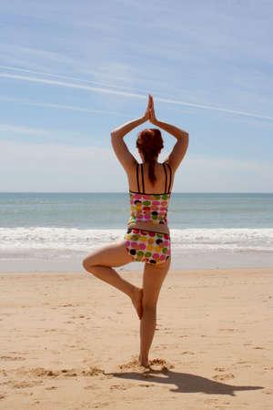 woman doing yoga tree pose Stock Photo - 390172
