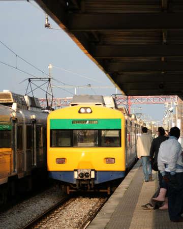 arrives: train arrives at train station