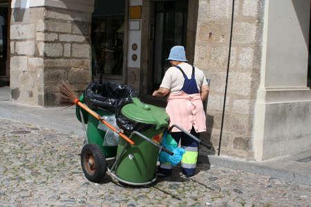 street cleaner in Evora, Portugal