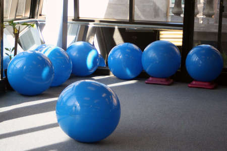 muscle toning: yoga balls at the gym Stock Photo