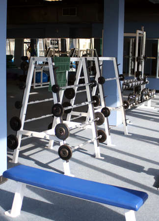 muscle toning: weights and equipment at a gym Stock Photo