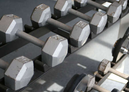 kilograms: weights and equipment at a gym Stock Photo