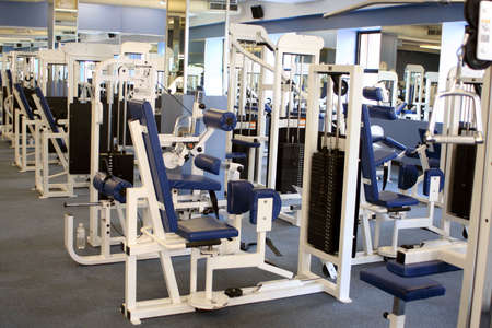 weights and equipment at a gym Stock Photo