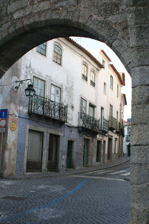 exits: arches along an old cobblestone street in Evora, Portugal