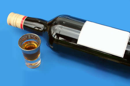 shooters: alcohol bottle with blank label and shot glass