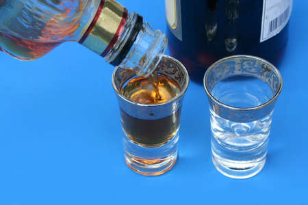 shooters: pouring an alcoholic drink into shotglass Stock Photo