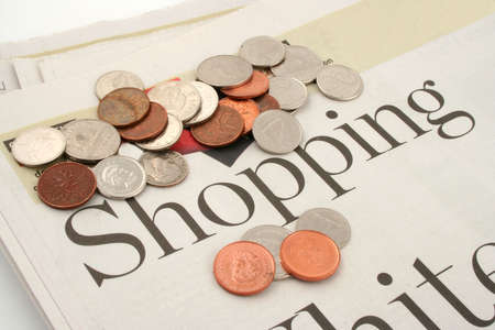 informational: shopping section of newspaper and coins