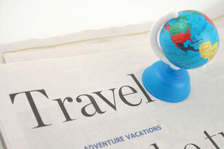 informational: travel section of newspaper and globe