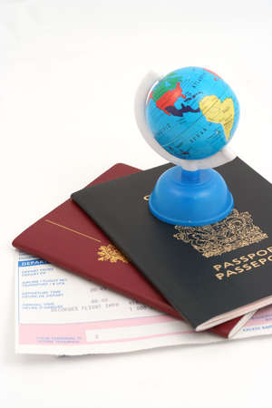 departing: travel documents and globe