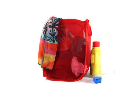 hamper: hamper with laundry and detergent