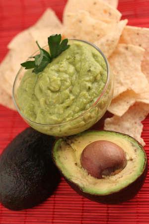 guacamole: avocado sliced, guacamole,and chips Stock Photo