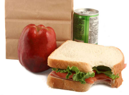 healthy lunch of ham sandwich with tomatoes and lettuce, vegetable juice and apple