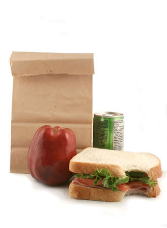 ham sandwich with tomatoes and lettuce, apple and juice