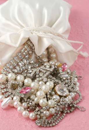 falling out: bag spilled over with jewels falling out