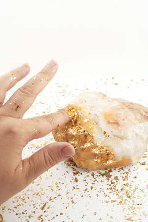 golden fingertip turns rock into gold