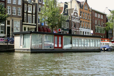gabled: Amsterdam canal with house boat and gabled houses