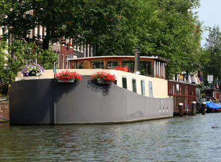 Amsterdam canal with houseboat Stock Photo - 513117