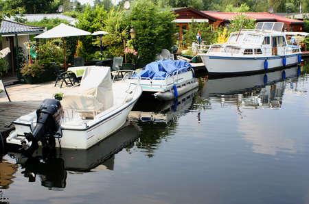 leisure boats in a small Amsterdam canal photo