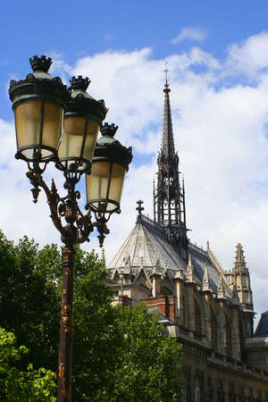 lampost: antique lampost with the spires of the chapel in the Palace of Justice, Paris, France