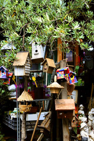 birdhouses and other crafts at a Paris market Stock Photo - 513022