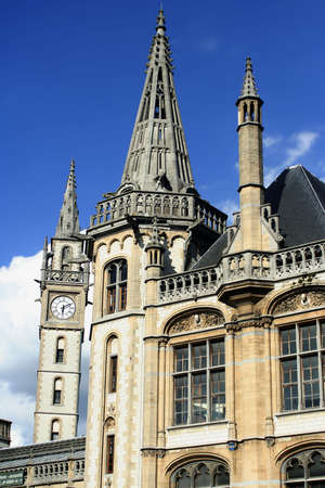 gabled: Gabled houses and clocktower in Gent, Belgium Stock Photo