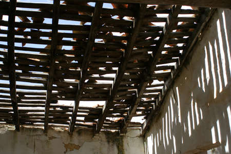 damaged roof: rural building thats falling apart Stock Photo