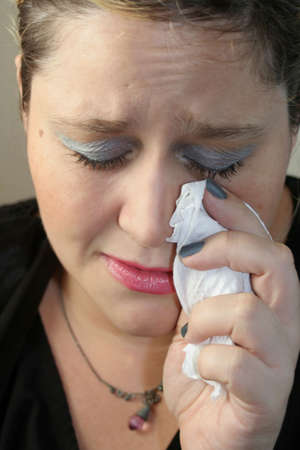 grieving woman crying with tissue