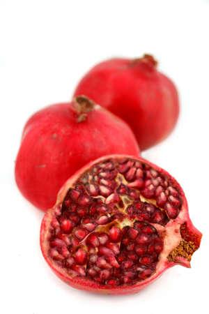 ripe, and fresh half and full pomegranate