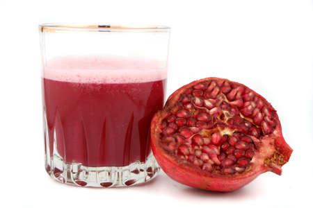 fresh half of  pomegranate and juice Stock Photo