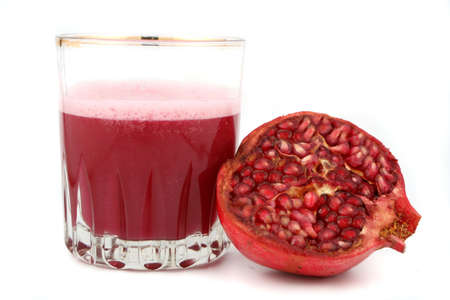 pomegranate juice: fresh half of  pomegranate and juice Stock Photo