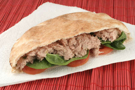 tuna with spinach and tomato in a whole wheat pita Stock Photo