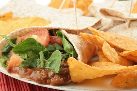 dinnertime: colorful mexican fajitas, and crunchy nacho chips Stock Photo