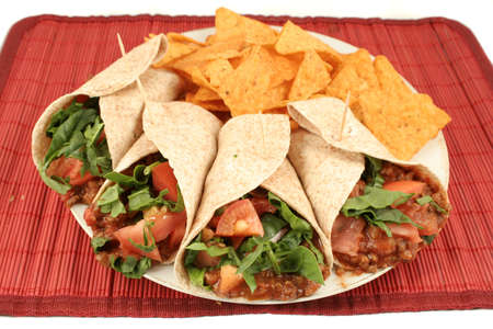 colorful mexican fajitas, and crunchy nacho chips Stock Photo