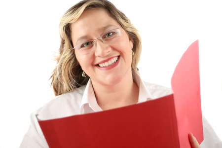 courteous: friendly smiling woman with file folder that could be a doctor or a businesswoman