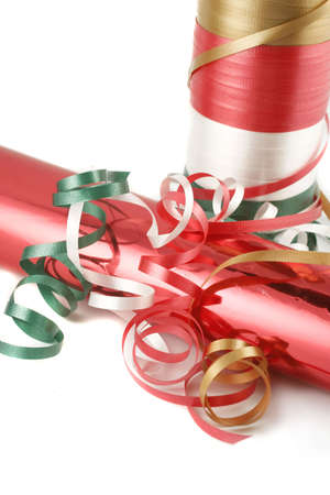 metallic gift wrapping, colorful ribbon, and confetti Stock Photo