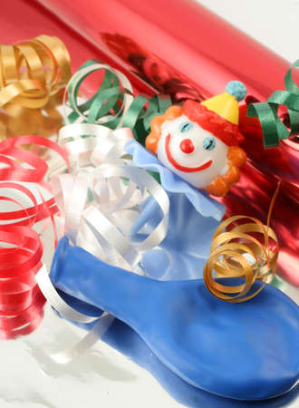 metallic gift wrapping, colorful ribbon, and confetti photo