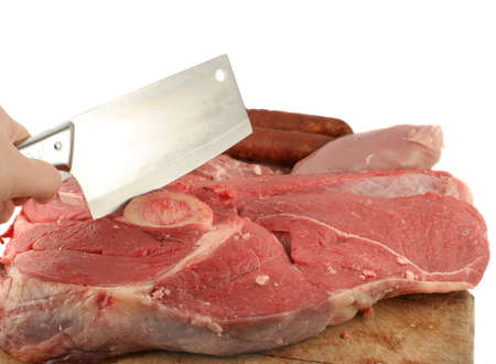the cleaver: slab of meat and meat cleaver on a cutting board Stock Photo
