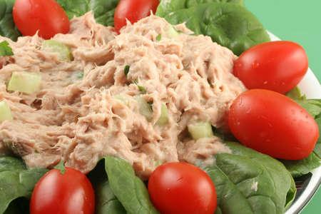 tuna mayo: healthy lunch of tuna salad with cherry tomatoes and spinach